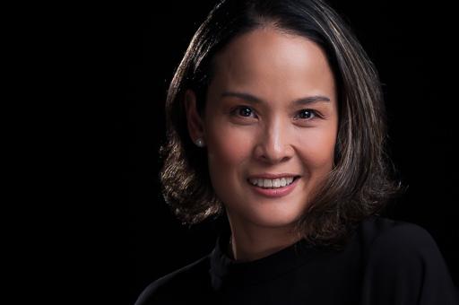 Lyda Aguinaldo Headshot on Black Background